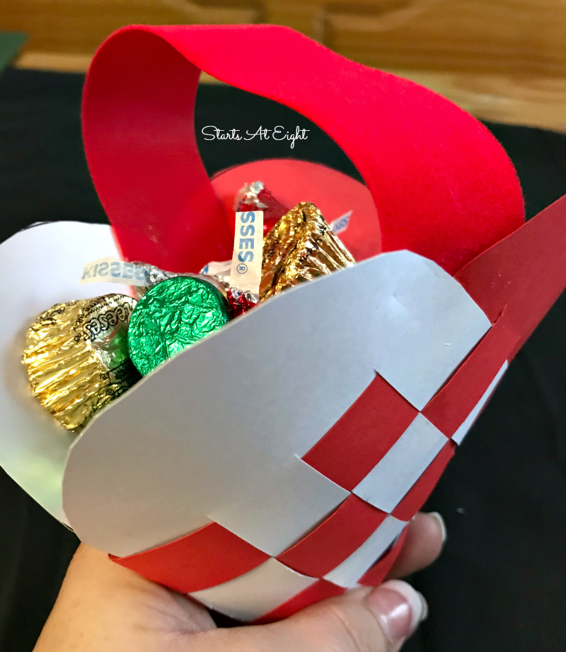 Christmas Crafts: Swedish Woven Heart Paper Craft Tutorial. Grab some card stock, ribbon, scissors, and glue to craft a woven heart basket or ornament. from Starts At Eight